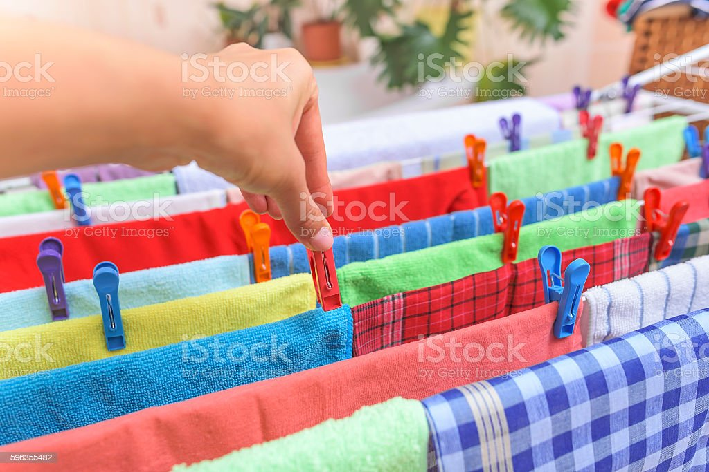 Hand hang on the clothespin clothing. royalty-free stock photo