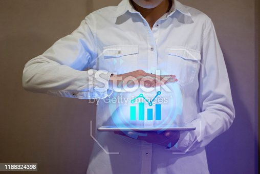1051659174 istock photo hand held modern communication devices. Business growth concepts 1188324396
