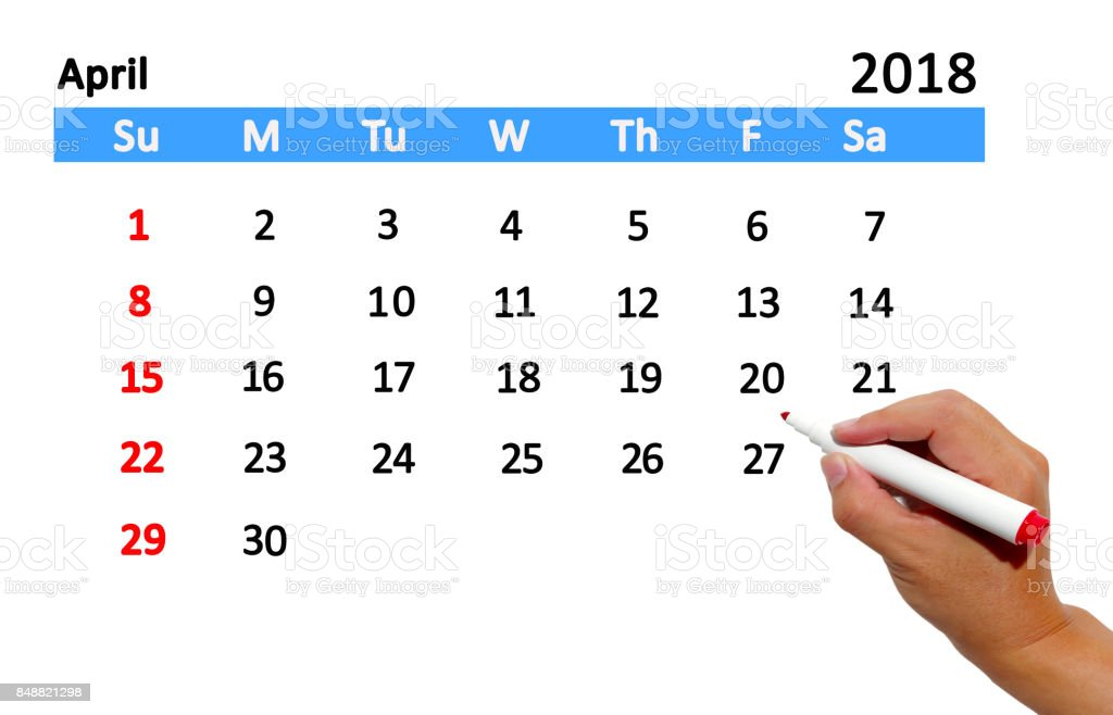 Hand highlighting date on calendar stock photo