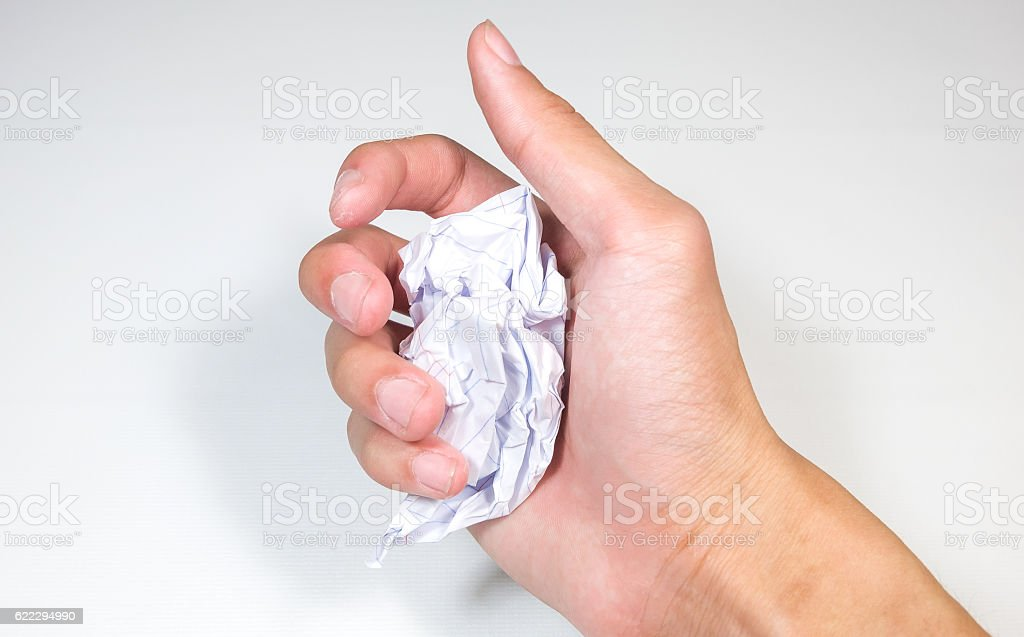 hand hold a crumpled paper ball - emotion concept stock photo