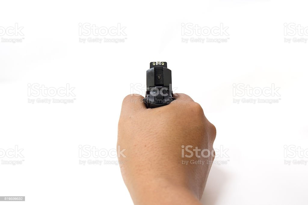 hand hold and aim pistol isolated on white background stock photo