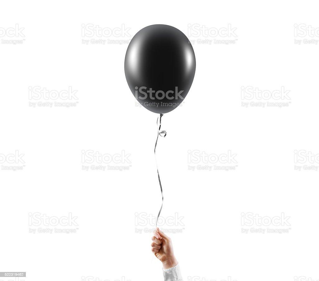 Hand hold blank black balloon mock up isolated. Balloon art stock photo