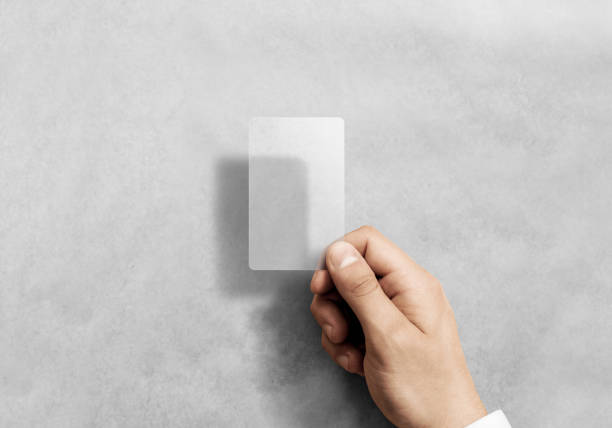 Hand hold blank vertical translucent card mockup with rounded corners stock photo