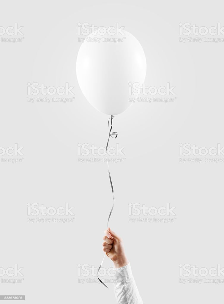 Hand hold blank white balloon mock up isolated. Baloon mockup. stock photo