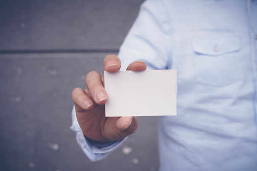 Hand hold blank white card mockup