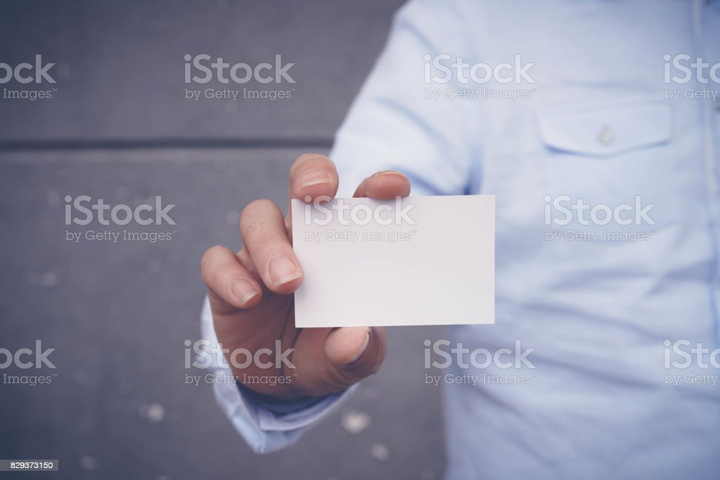 Hand hold blank white card mockup stock photo