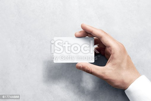 istock Hand hold blank white card mockup with rounded corners 617744688