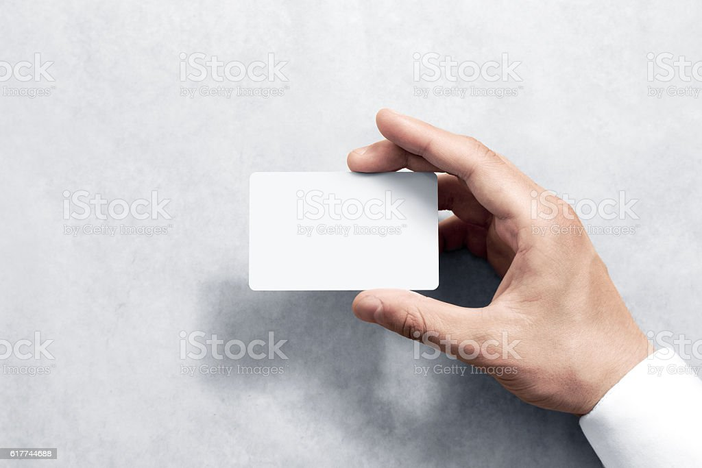 Hand hold blank white card mockup with rounded corners stock photo