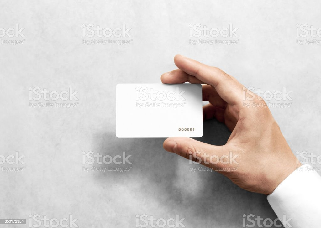 Hand hold blank white loyalty card mockup with rounded corners stock photo