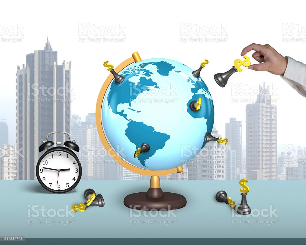 hand hold dollar chess on terrestrial globe with alarm clock stock photo