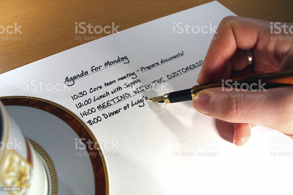 Hand hold fountain pen, coffee and agenda royalty-free stock photo