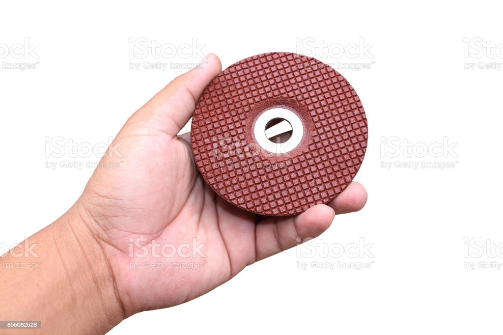 Hand hold grinding wheel on isolated stock photo