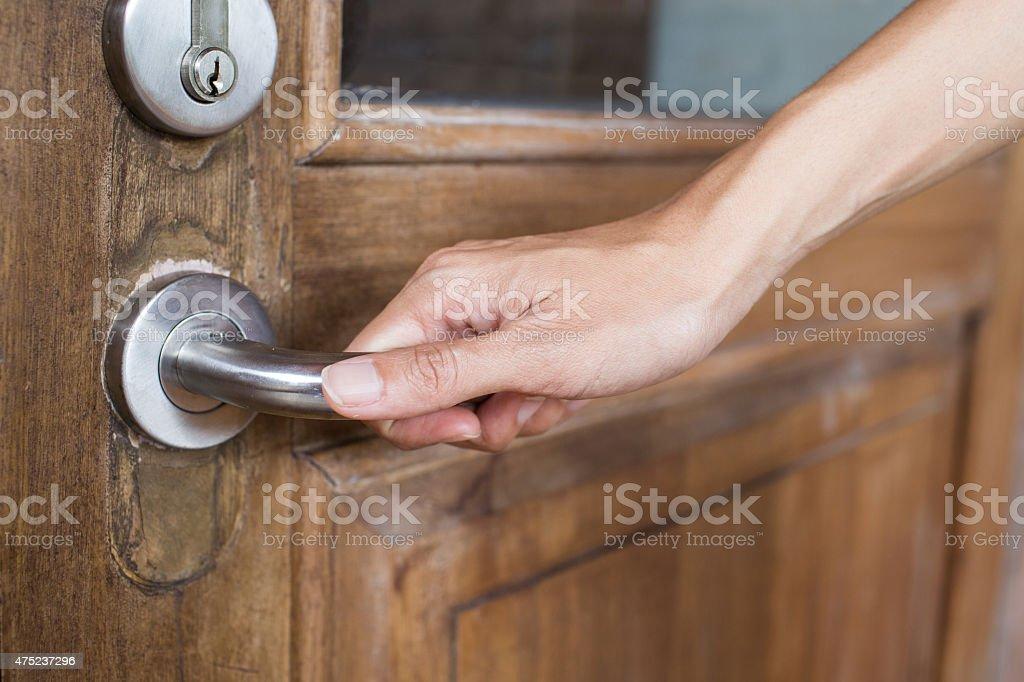 hand hold handle of wood door stock photo