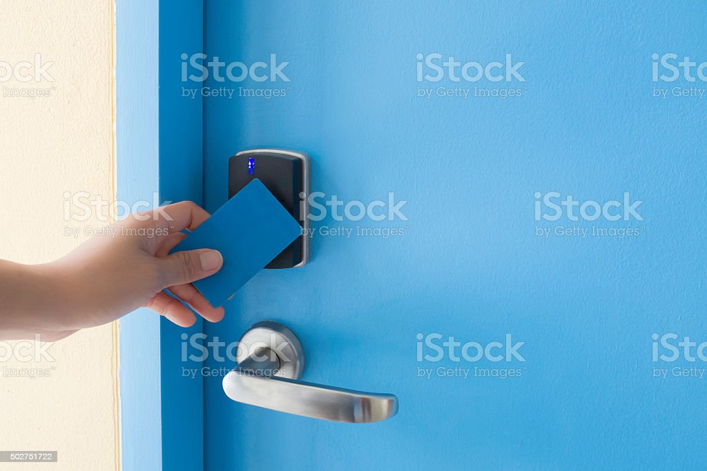 hand hold key card touch on electronic key pad lock stock photo