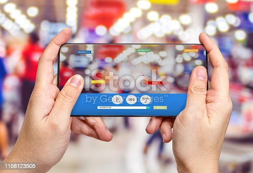 890476604 istock photo Hand hold mobile phone and using augmented reality ( AR ) app for see promotion sale in supermarket store,Digital lifestyle Technology concept 1158123505