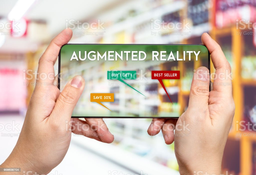 Hand hold mobile phone and using augmented reality ( AR ) app for see promotion sale in supermarket store,Digital lifestyle Technology concept. stock photo