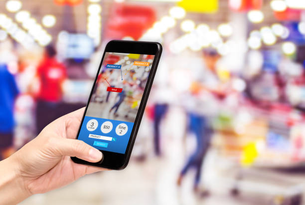 hand hold mobile phone and using augmented reality ( ar ) app for see promotion sale in supermarket store,digital lifestyle technology concept. - realtà aumentata foto e immagini stock