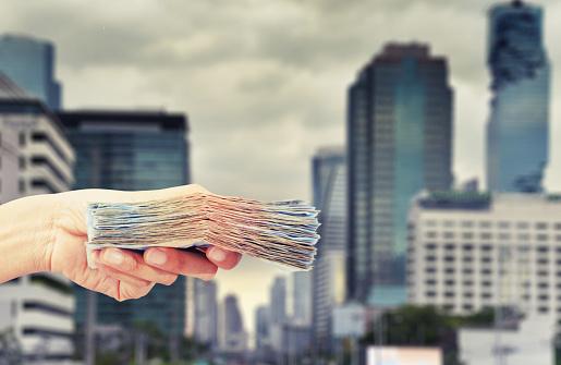 istock hand hold money 823221560