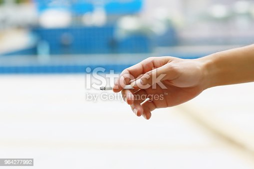 hand hold on a cigarette. image for background, wallpaper and copy space. campaign to stop smoking concept.