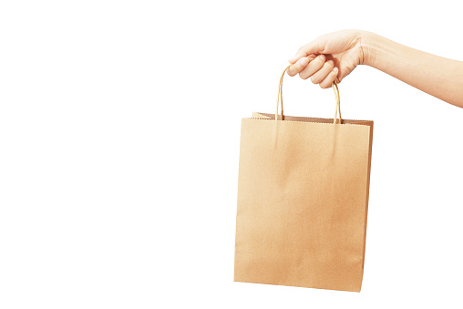 hand hold paper bag