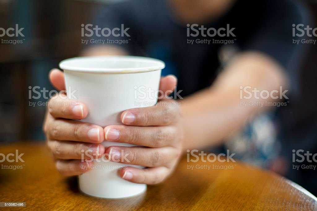 hand hold paper cup stock photo