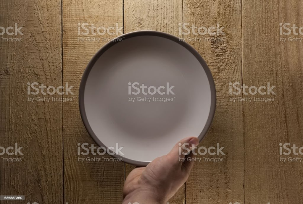 Hand hold plate on wood royalty-free stock photo