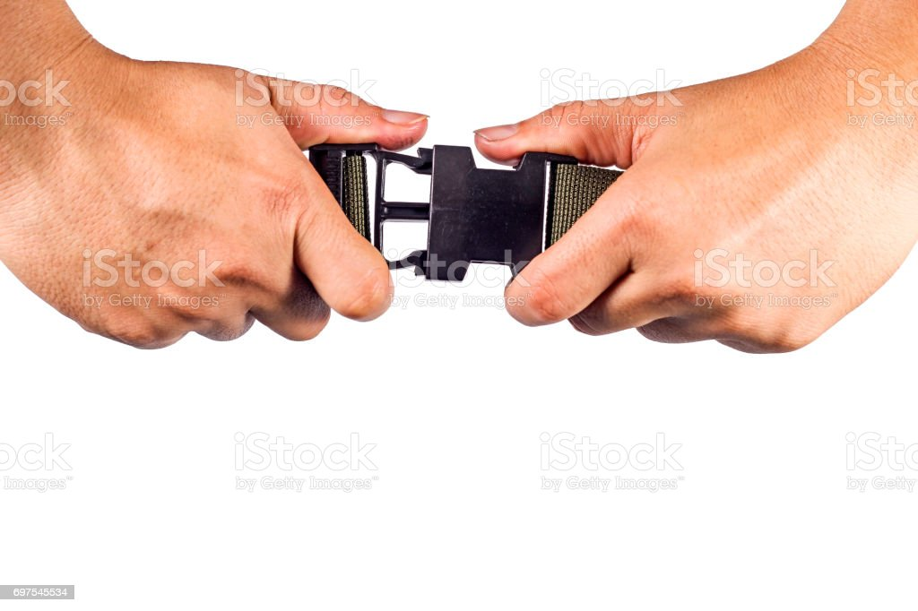 Hand hold side release buckle from plastic with green belt nylon stock photo
