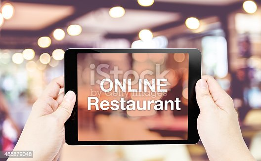 istock Hand hold tablet with Online restaurant word on screen 485879048