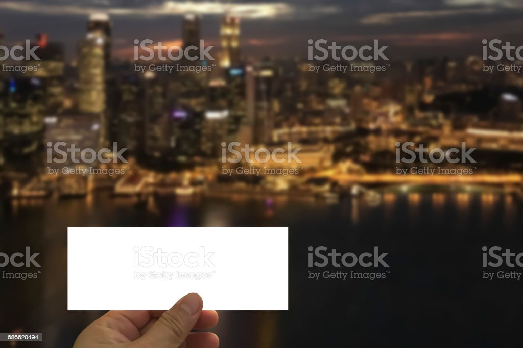 Hand hold Ticket to surprise with city skyline background. royalty-free stock photo