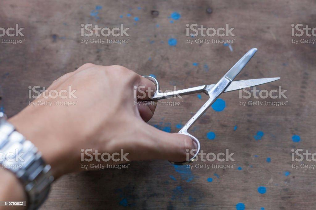 hand hold towel Scissors tongs on Mechanic desk stock photo