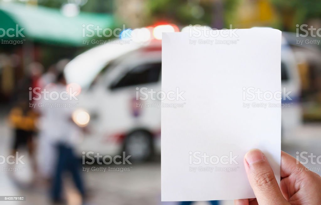 hand hold white paper with Ambulance responding to emergency call stock photo