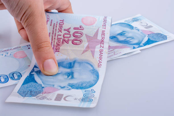 Hand holding 100 Turksh Lira banknotes  in hand stock photo