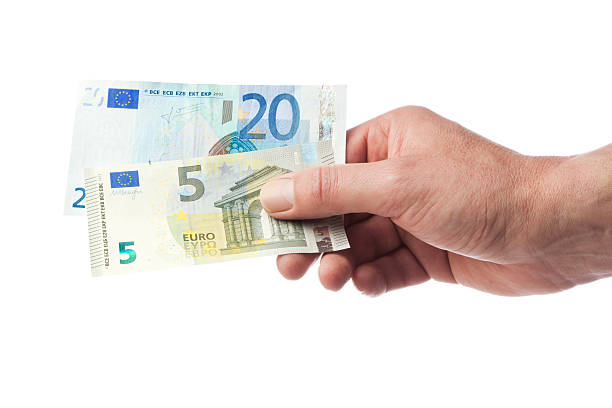Hand holding 25 euros stock photo