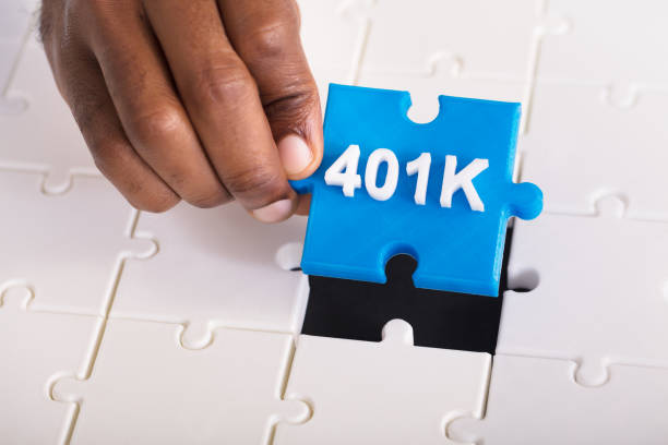 Hand Holding 401k Jigsaw Puzzle Overhead View Of A Person's Hand Holding 401k Blue Jigsaw Puzzle 401k stock pictures, royalty-free photos & images