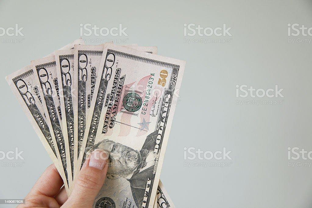 Hand holding $50 dollar bills stock photo