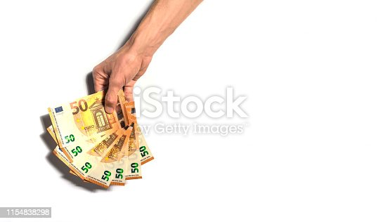 Hand holding 50 euro bills from above, isolated on white background. Big copy space in the right side. Concept of making money, gambling, victory...