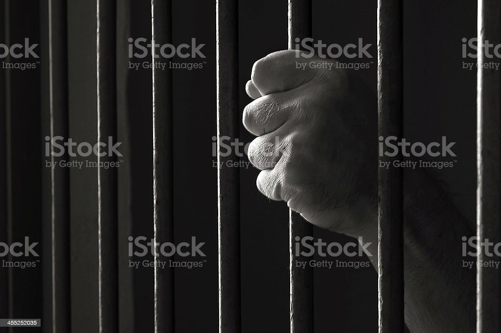 Hand holding a bar stock photo
