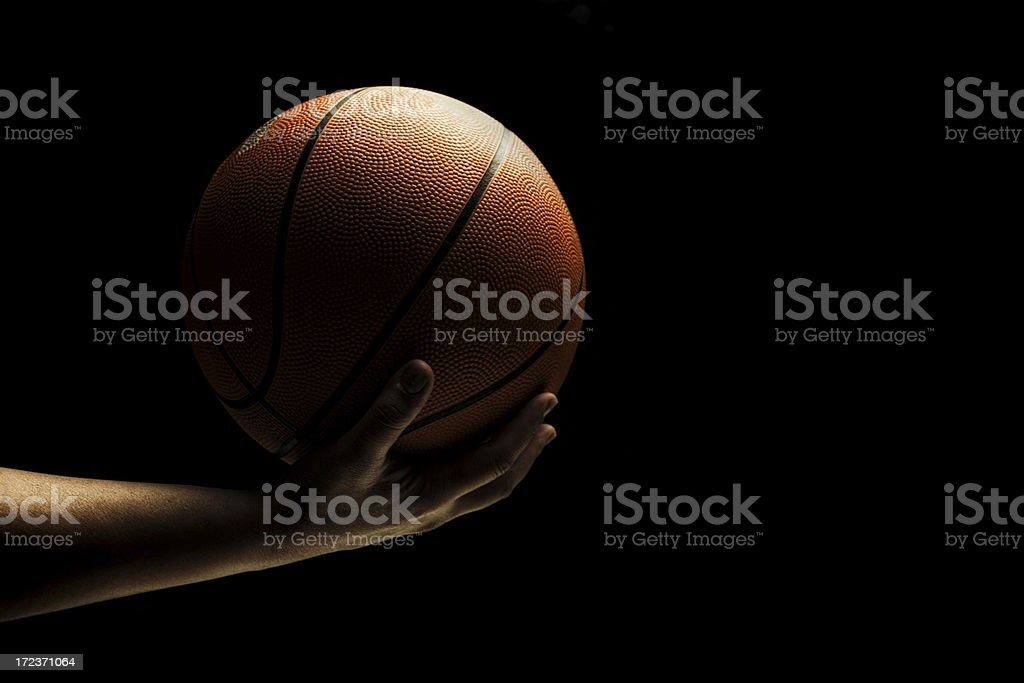 hand holding a basketball stock photo