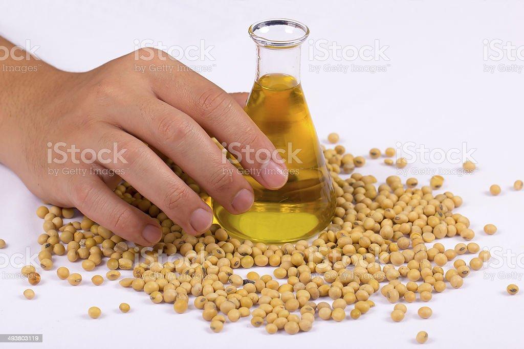 hand holding a beaker stock photo