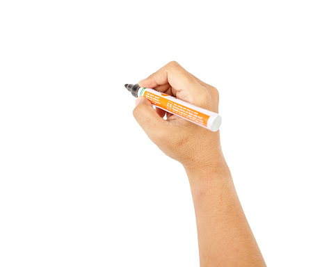 A hand holding a black marker, isolated on white background