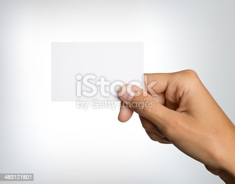 Naturally groomed female hand holding a business card on white background. Nikon D800e. Converted from RAW.
