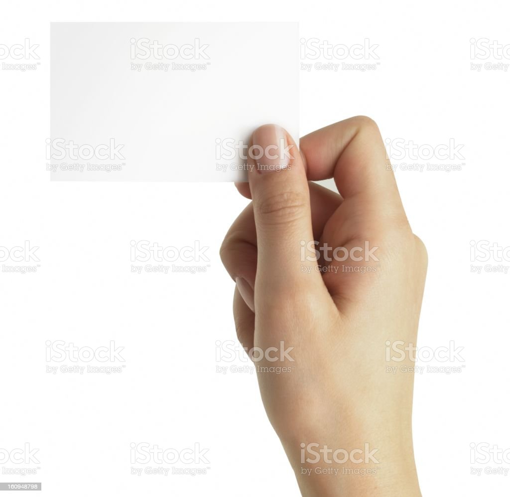 A hand holding a blank white business card royalty-free stock photo