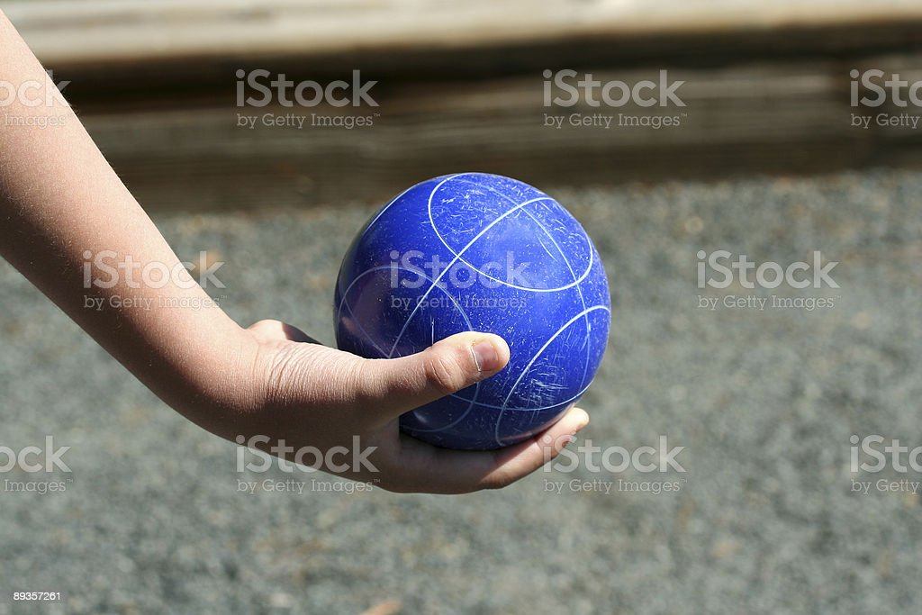 Hand holding a bocce ball stock photo