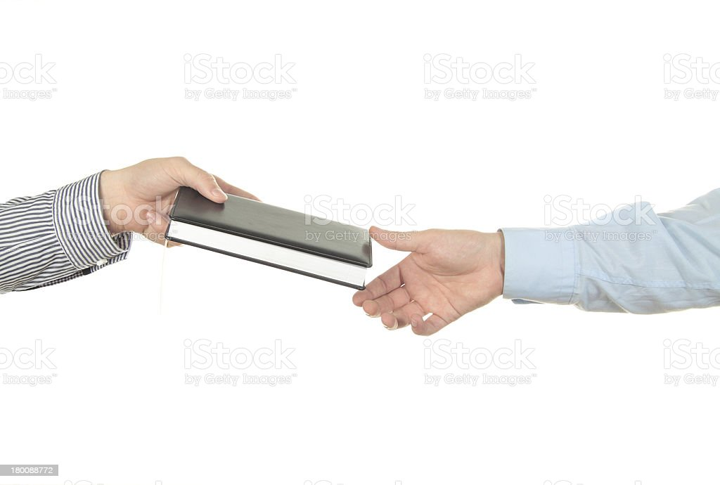 Hand holding a book royalty-free stock photo