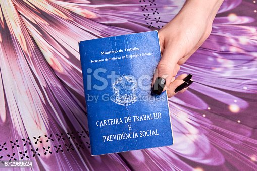 872976132 istock photo Hand holding a Brazilian social security document 872969524
