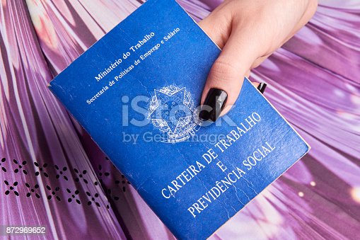 872976132 istock photo Hand holding a Brazilian social security document 872969652