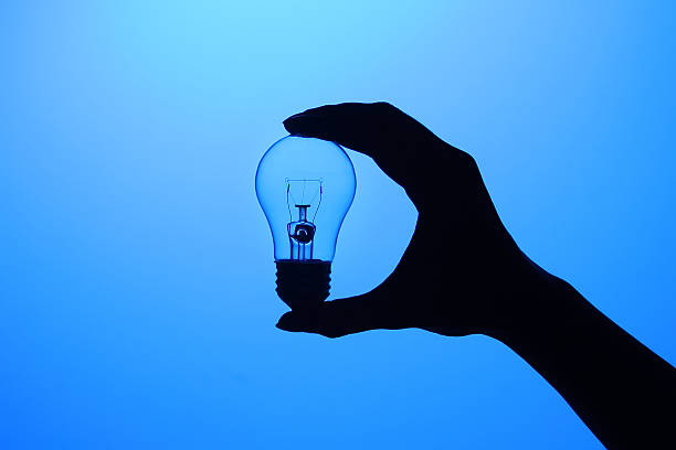 Hand holding a bulb stock photo