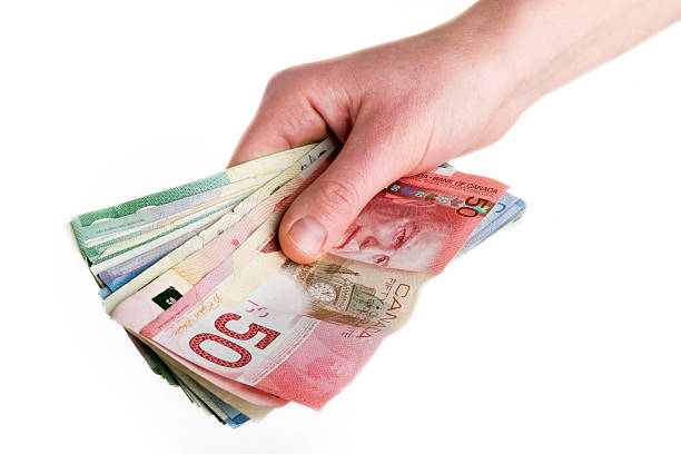 Hand holding a bunch of euro notes stock photo