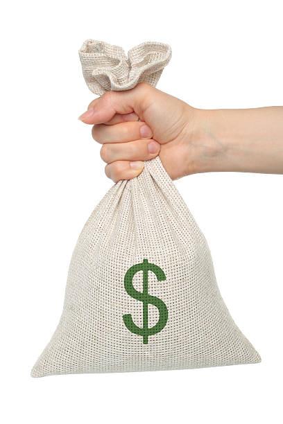 Hand hält eine Tasche mit Geld – Foto