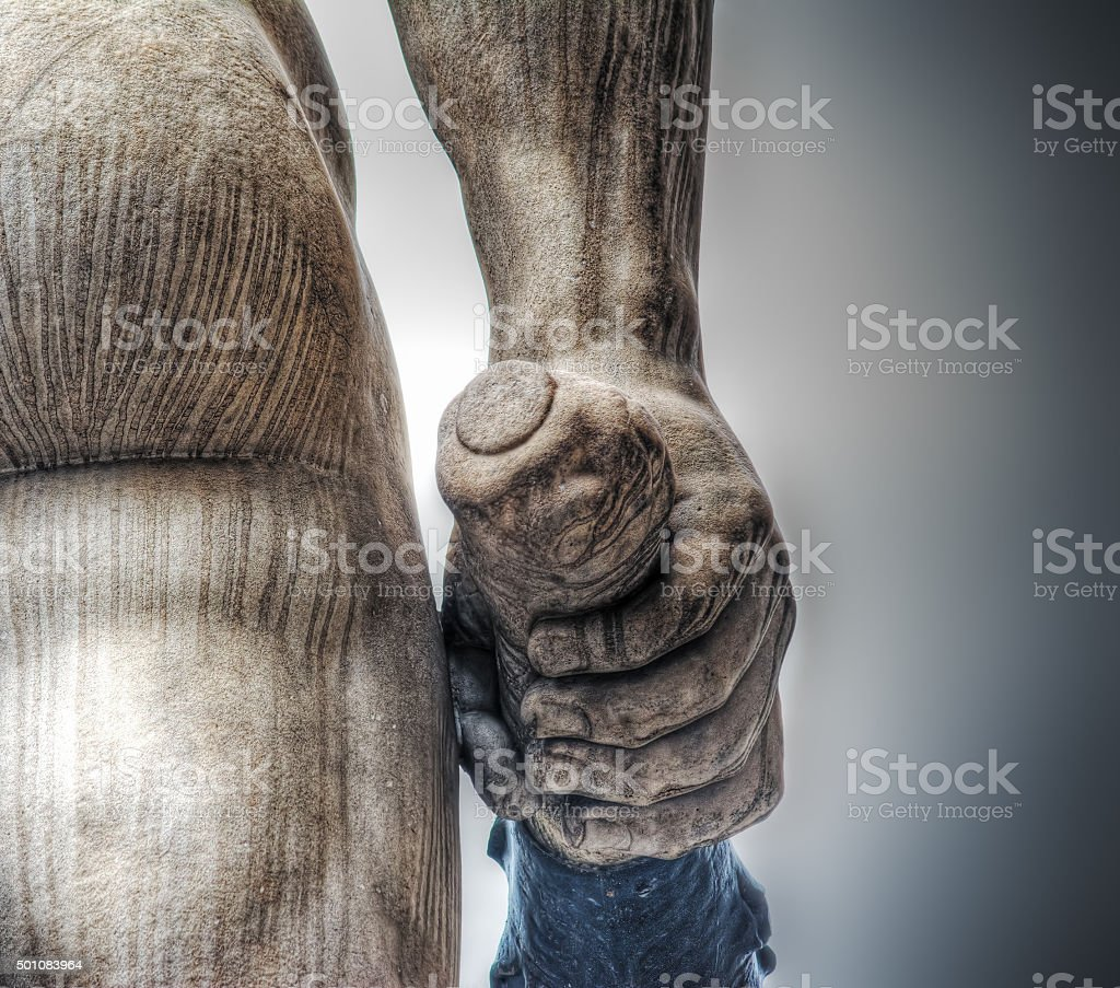 hand holding a club in Hercules and Cacus statue stock photo